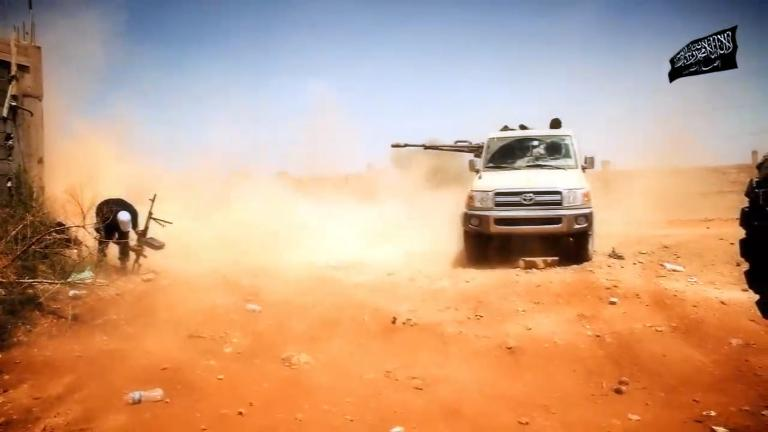 wpid-an-video-grab-made-available-on-october-9-2014-by-the-official-islamist-media-outlet-of-benghazi-based-islamist-ansar-al-sharia-group-al-raya-media-foundation-allegedly-shows-militants-from-the-group-during-a-battle-in-benghazi-libya.jpg