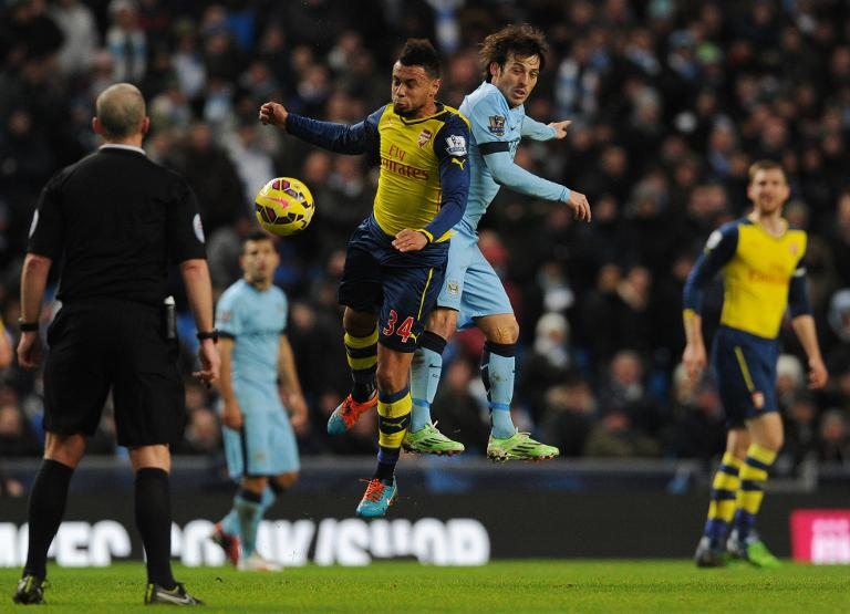 wpid-arsenals-francis-coquelin-2nd-l-and-manchester-citys-david-silva-2nd-r-during-their-premier-league-match-at-etihad-stadium-on-january-18-2015.jpg