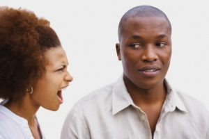 Upset young woman shouting at a man --- Image by © Moment/cultura/Corbis