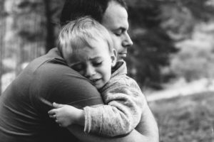 Father-hugging-his-crying-son-545093904_1258x838