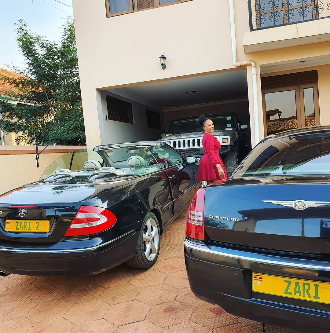 Zari posing with her car collection